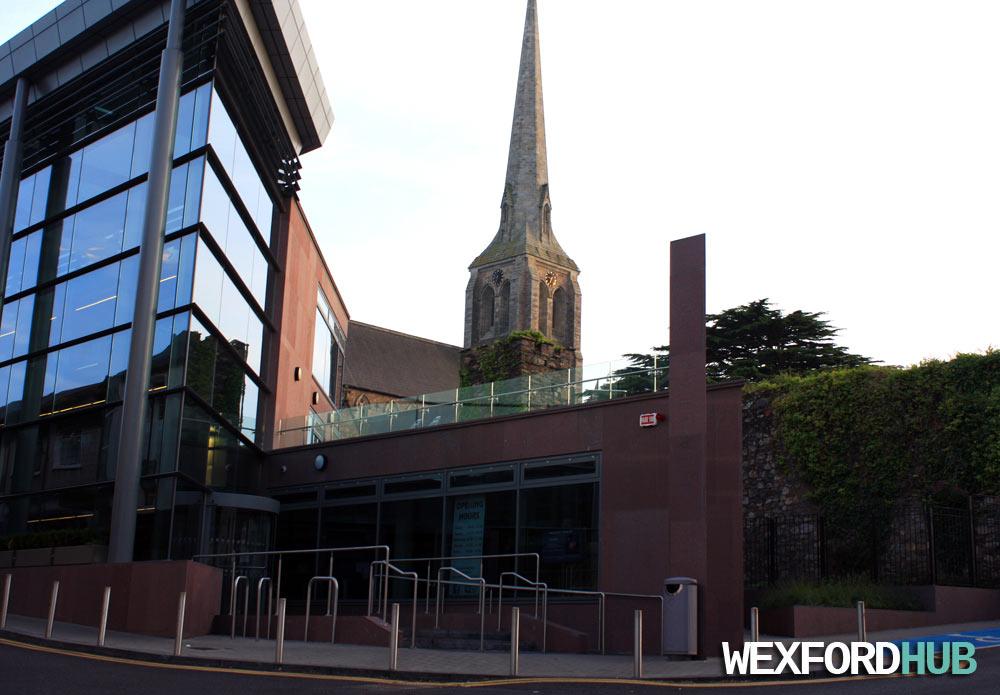 Rowe Street Church alongside the Wexford Library.